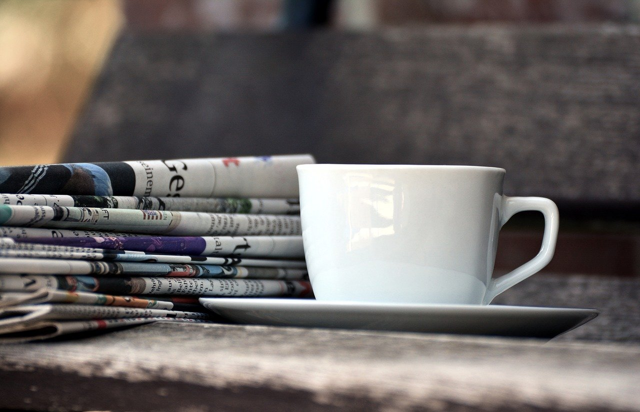 cup, newspapers, magazines